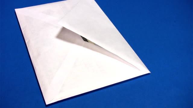 Bribe - thousand dollars in postal envelope video
