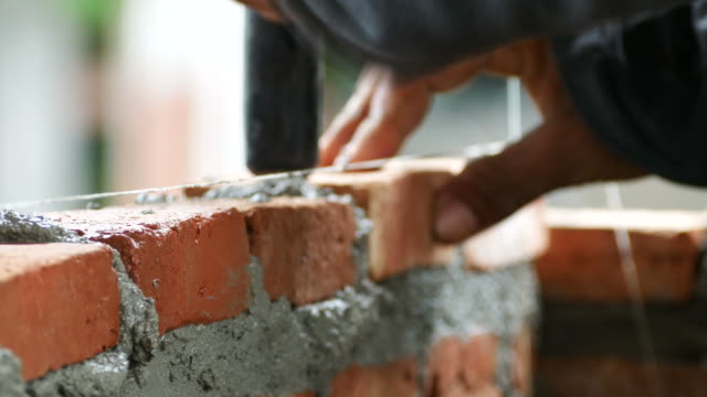 brick installation - mattone video stock e b–roll