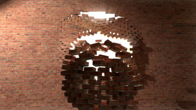 brick wall break through demolish smash escape to white light 2 - new job bildbanksvideor och videomaterial från bakom kulisserna