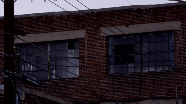 Brick Warehouse Exterior Windows Brick Warehouse windows at dusk loft apartment stock videos & royalty-free footage