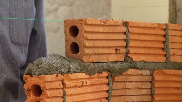 bricklayer construction brick wall, 4k video