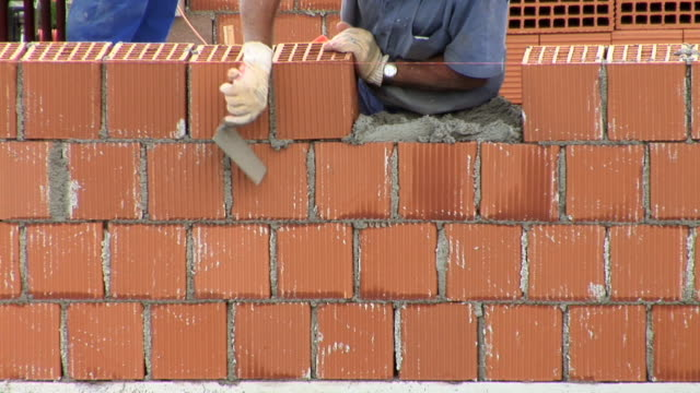 HD TIME-LAPSE: Bricklaying HD1080i: Bricklayers are building a wall. Time-lapse. Tripod. brick stock videos & royalty-free footage