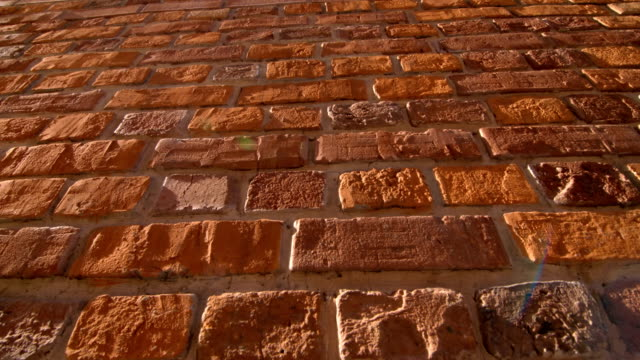 Brickwork in the sun as background