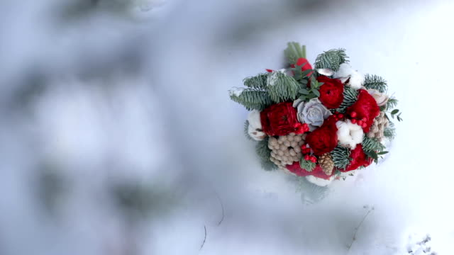 Bridal bouquet with fir branches in the snow. video