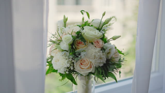 bridal bouquet with window in background - stock video - триллиум стоковые видео и кадры b-roll