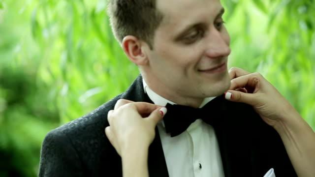 Bride adjusting groom's tie video