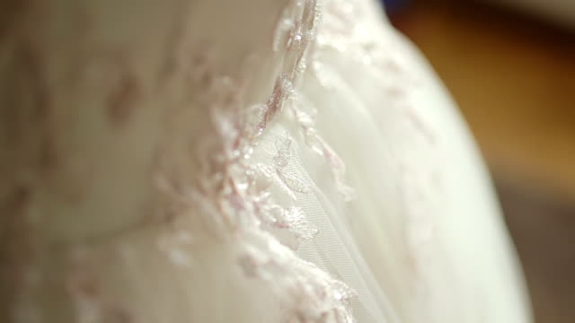 CLOSE UP SELECTIVE FOCUS ZO Bride adjusting wedding dress CLOSE UP SELECTIVE FOCUS ZO Bride adjusting wedding dress tulle netting stock videos & royalty-free footage