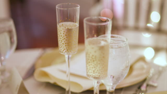 Bride and Groom Champagne Flutes at Wedding Reception