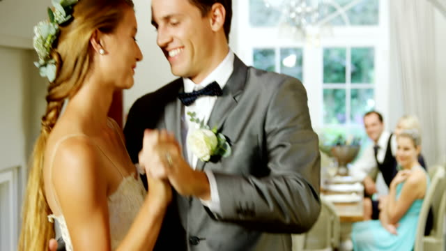 Bride and groom dancing in the hall 4k video