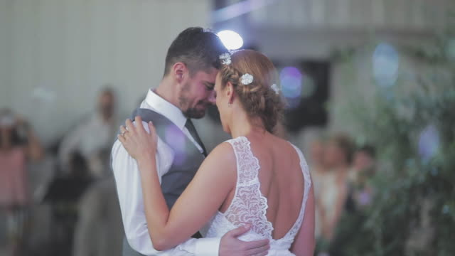 bride and groom dancing together their first dance - matrimonio video stock e b–roll