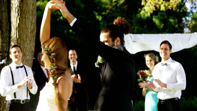 Bride and groom dancing with guests clapping In background 4K 4k video
