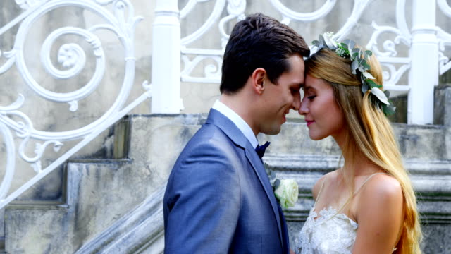 Bride and groom embracing each other 4K 4k video
