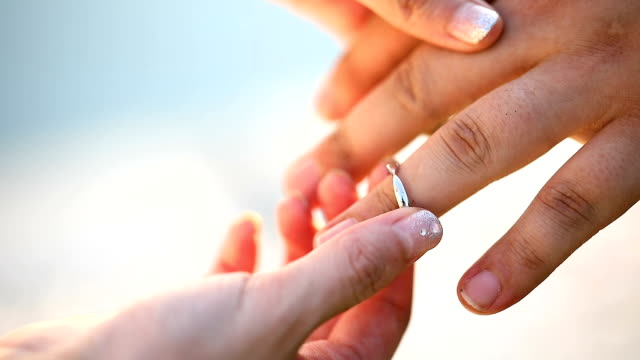 bride and groom exchanging wedding rings in wedding ceremony. - mano donna dita unite video stock e b–roll