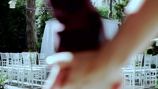 bride and groom holding hands and walking down to wedding arch - video di matrimonio video stock e b–roll