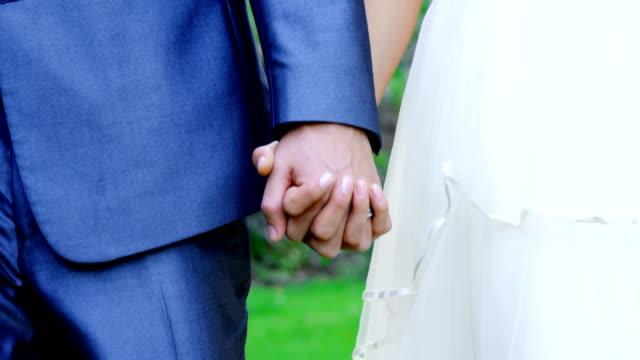Bride and groom holding hands at wedding 4K 4k video