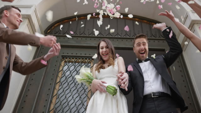 SLO MO Bride and groom stepping out of the church video