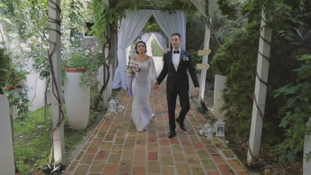 Bride and groom walking video