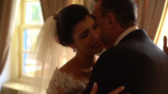 bride and her father on affection moments before wedding ceremony - video di matrimonio video stock e b–roll