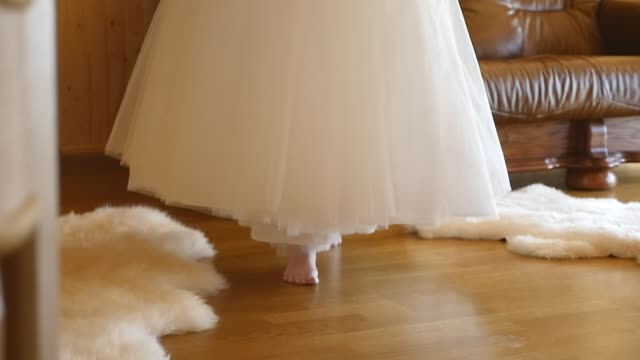 Bride carries a wedding dress video