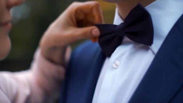 Bride correcting bow tie her groom video