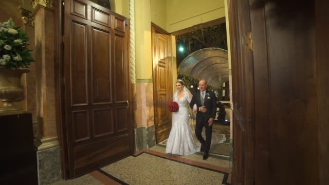 Bride entering in the church with her father