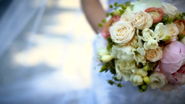 Bride holding beautiful rose Bouquet on wedding day. video