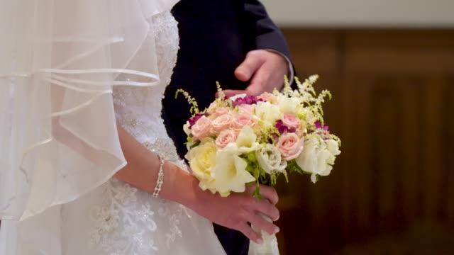 Bride holding bouquet video