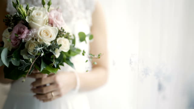 bride holding flowers in hands