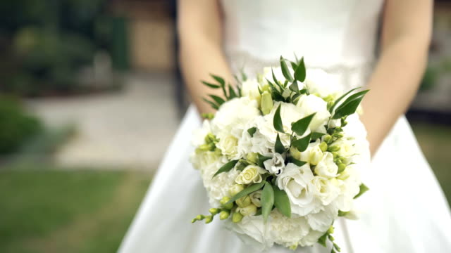 bride holding flowers - bouquet video stock e b–roll