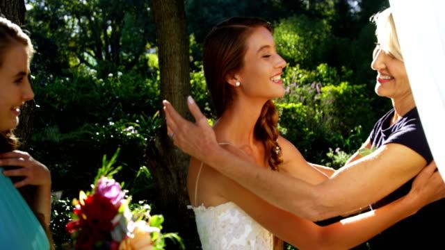 Bride hugging her mother happily 4K 4k video