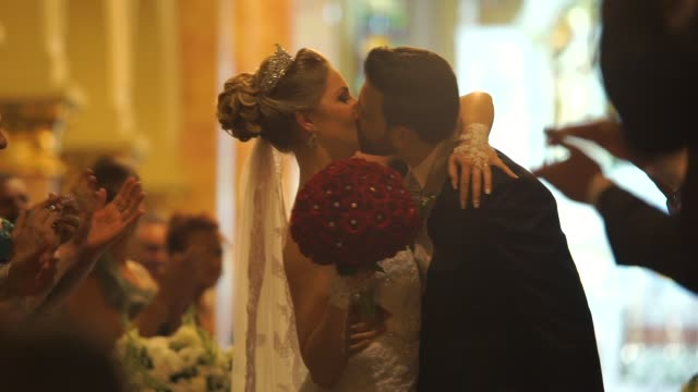 Bride kissing the groom in the church