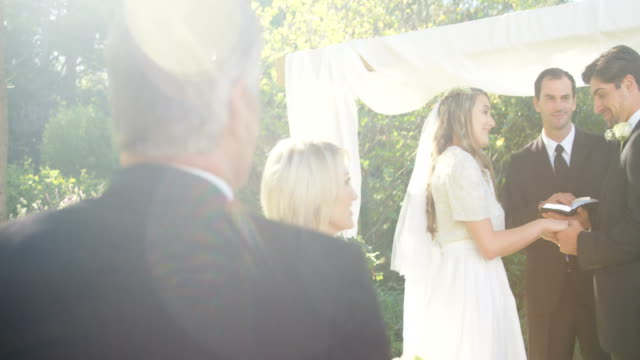 Bride parents are happy about marriage talking with each other 4K 4k video