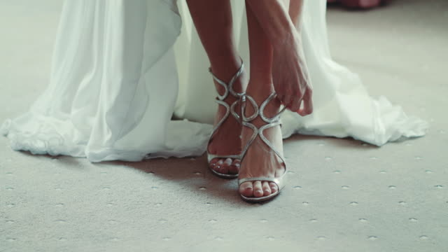 Bride Putting On Shoes For Wedding Day video