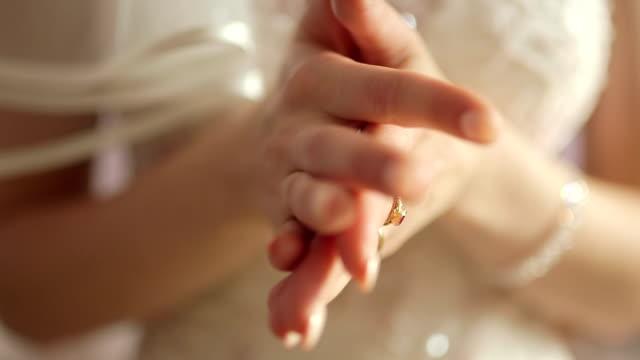 CLOSE UP SELECTIVE FOCUS Bride rubbing hands video