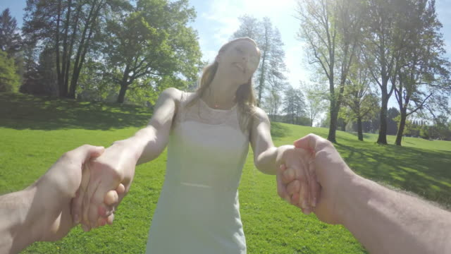 POV Bride smiling and spinning with the groom in the park video