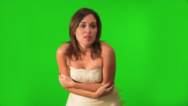 Bride to be feeling cold. Shot on green screen video