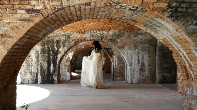 Bride Walking Under Brick Arches video