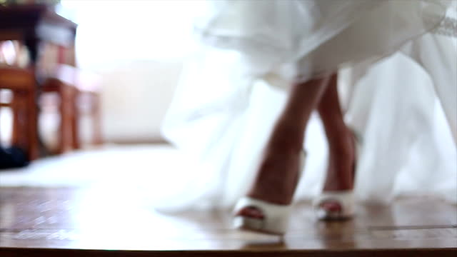 bride wearing wedding shoes - wedding fashion stock videos and b-roll footage