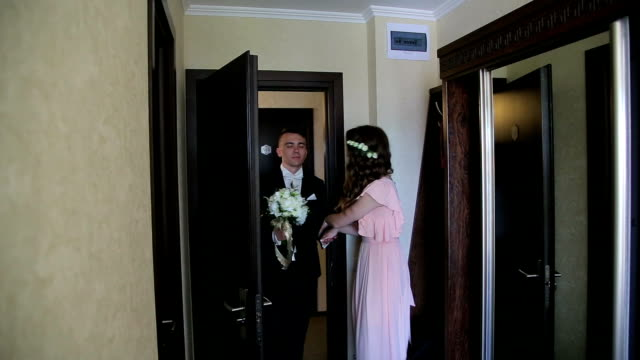 Bride's friend meets groom and leads him to bride