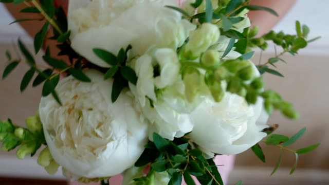 Bridesmaid holding bouquet of flowers with peony video