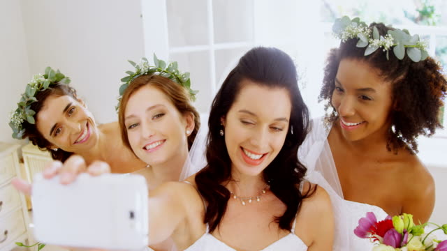 Bridesmaids and bride making pout while taking a selfie4K 4k video