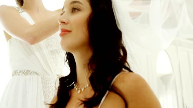 Bridesmaids putting veil on bride 4K 4k video