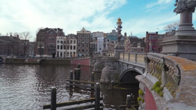 Bridge in Amsterdam downtown, the Netherlands with Amstel river