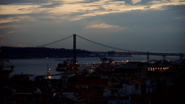 Bridge of 25th april in Lisbon at evening. Bridge of 25th april in Lisbon at evening. ponte 25 de abril stock videos & royalty-free footage