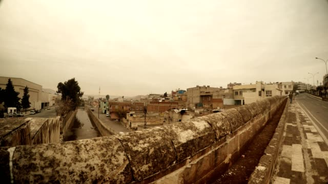 Bridge under Canal in Historical Centre of Urfa Far Slum Area Cloudy Wintry Day Sanliurfa video