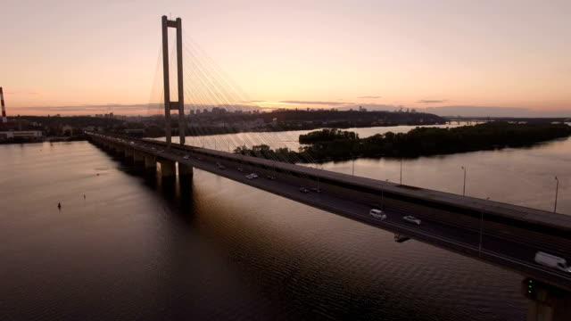 Bridge with trafic over the river at sunset aerial drone footage video