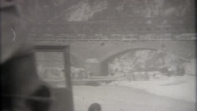 Bridge World War II 1945 GI's cross a bridge in Austria during World War II. black and white architecture stock videos & royalty-free footage