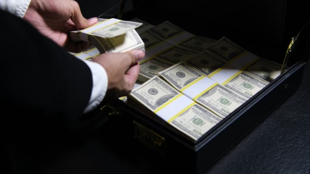 briefcase full of money - money bills and currency stock videos & royalty-free footage