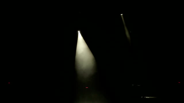 bright beautiful rays of light on an empty stage before the concert. - riflettore lenticolare video stock e b–roll
