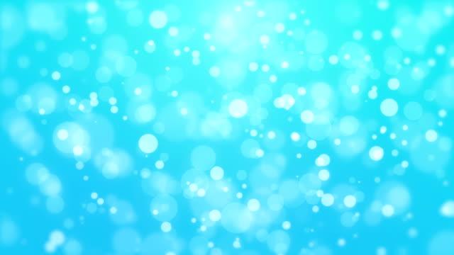 Fond de particules bleues lumineuses - Vidéo